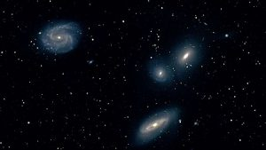 کهکشانها با پیوستن به گروه، یک سوم جرمشان را از دست میدهند